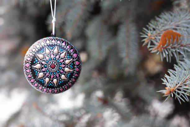 Christmas decor ball hanging on the tree stock photo