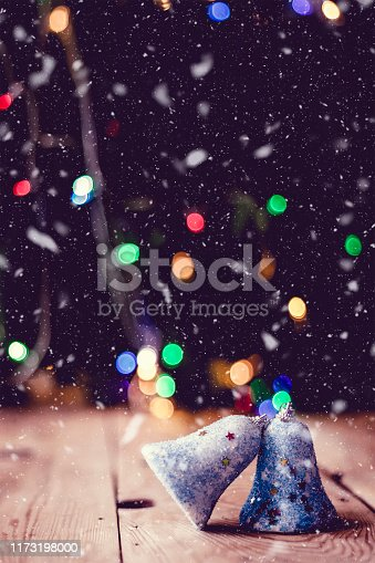 istock Christmas decor with bright bokeh lights. Magic Winter at Christmas Time 1173198000