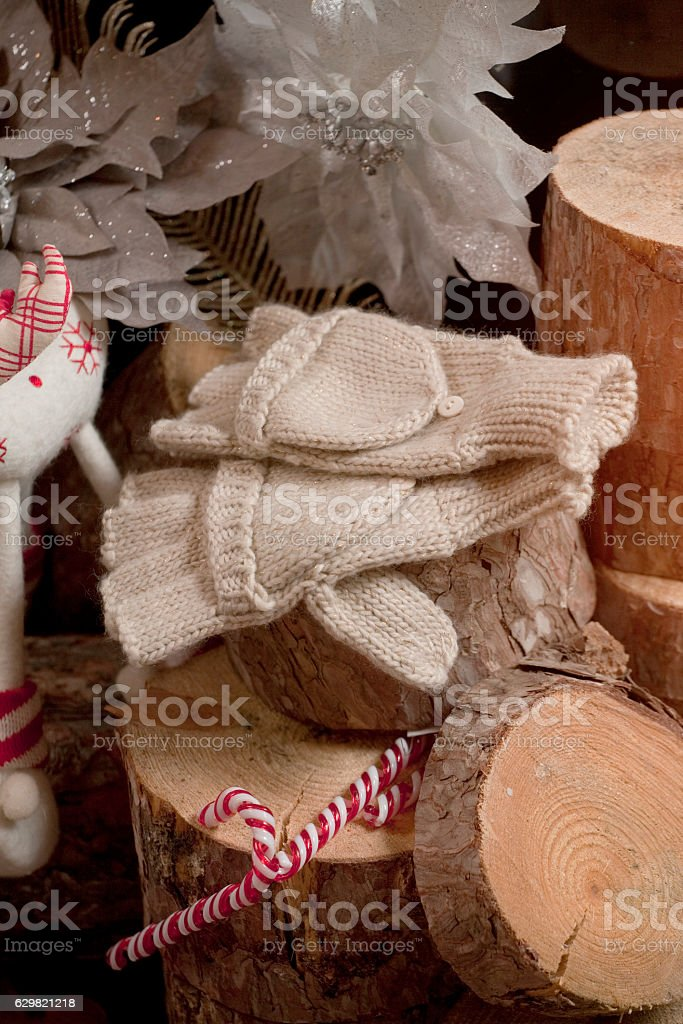 Christmas decor with woolen gloves stock photo