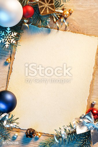 istock Christmas decorated fir tree with greeting card 627030166
