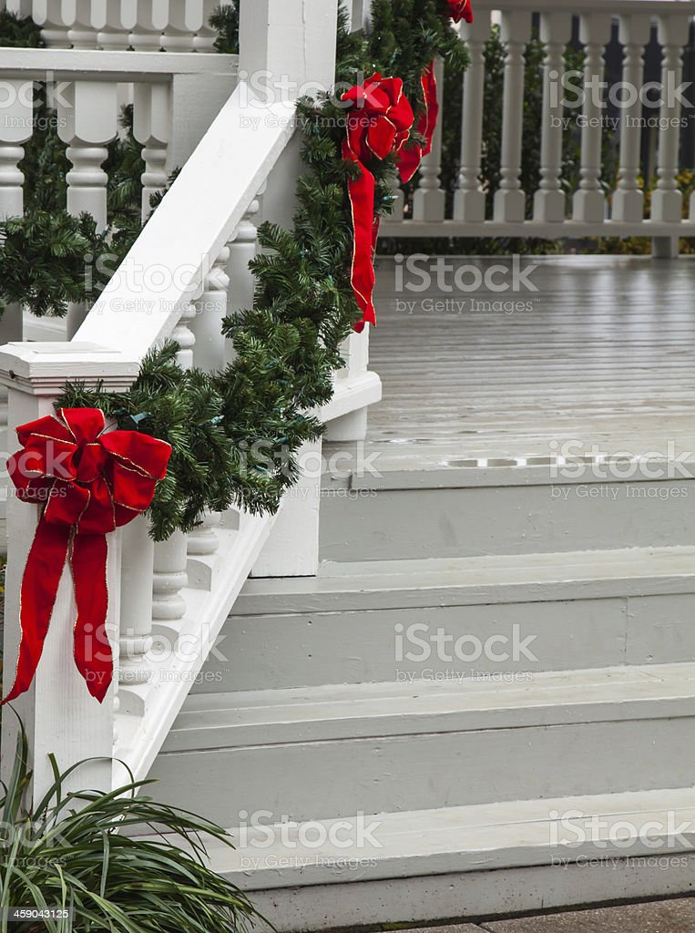 Christmas decorated front steps stock photo