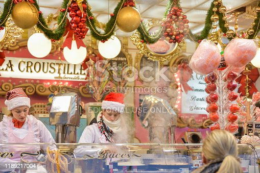 ROUEN, FRANCE - DECEMBER 16, 2018: Christmas decorated Kiosk with sweets at the Fair