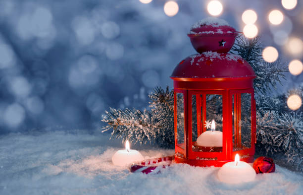 Christmas decorated lantern and candles on snow with copy space Christmas decorated lantern and candles on snow with copy space lantern stock pictures, royalty-free photos & images