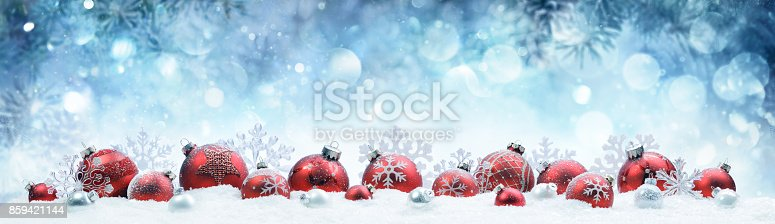 istock Christmas - Decorated Red Balls On Snow With Fir Branches 859421144