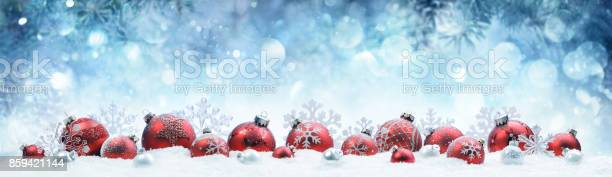 Christmas decorated red balls on snow with fir branches picture id859421144?b=1&k=6&m=859421144&s=612x612&h=4uxlyx5mx lvugpw0pmk2aqi rlgr9jo8z tp 2zhkq=