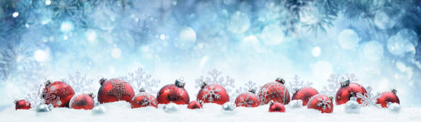 Christmas - Decorated Red Balls On Snow With Fir Branches stock photo