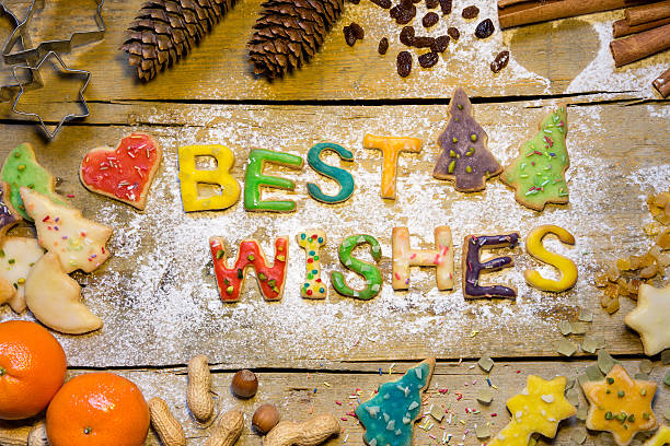 christmas decoration and cookie letters on wooden table, best wi - zimt vorteile stock-fotos und bilder