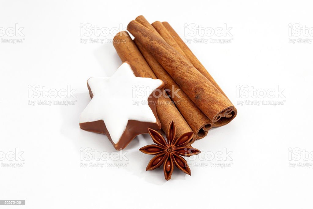 Christmas decoration, anise and cinnamon star on white background stock photo