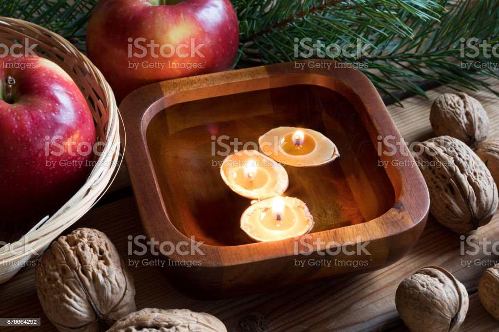Christmas Floating Candles.Christmas Decoration Apples Pine Branches Walnuts And