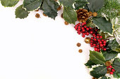 istock Christmas decoration arrangement with holly, berries and pine cones 186221026