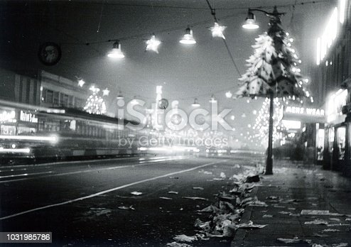 Los Angeles, California, USA, 1950. Christmas decoration on a main street in Los Angeles. Furthermore: Long Exposure, lights chains, lighting, lamps, advertising, shops, paper, tram, sidewalk and buildings.