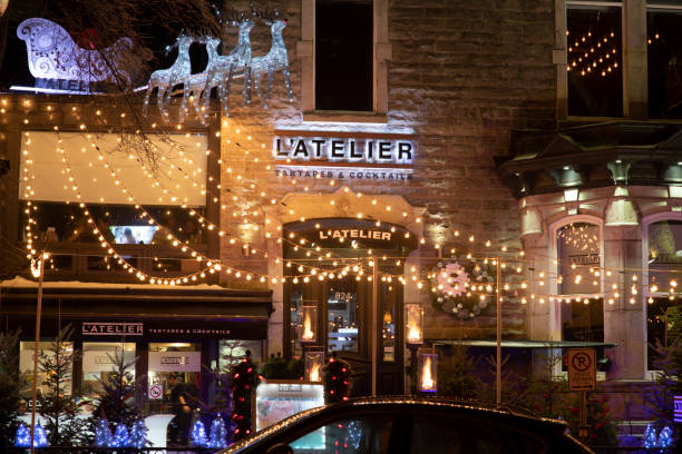 Christmas decoration at L'Atelier restaurant at night in historic district of Quebec City