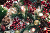 Christmas decoration background with candle and electric lights on rustic wooden table. Christmas themes.