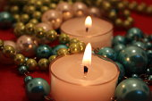 Christmas decoration candles lightening with flame