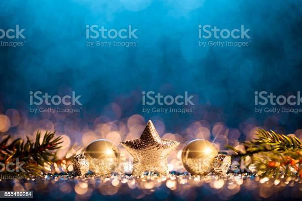Christmas decoration defocused gold blue bokeh picture id855486284?b=1&k=6&m=855486284&s=612x612&h=qddkiy8mpuocyx9ilf1n2jzq ornobpbhnqred8hysy=