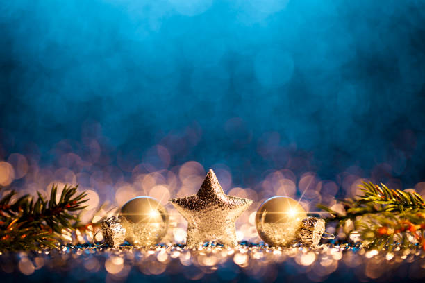 Christmas Decoration - Defocused Gold Blue Bokeh Decorative christmas still life. Abstract christmas trees on gold and blue glitter background. december stock pictures, royalty-free photos & images