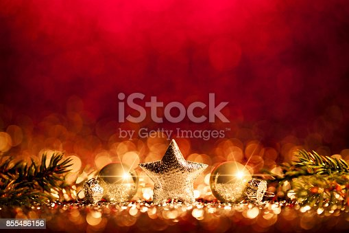 istock Christmas Decoration - Defocused Gold Red Bokeh 855486156