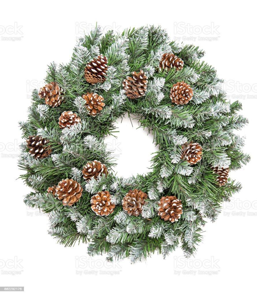 Jul dekoration vintergröna kottar kransen vit bakgrund bildbanksfoto