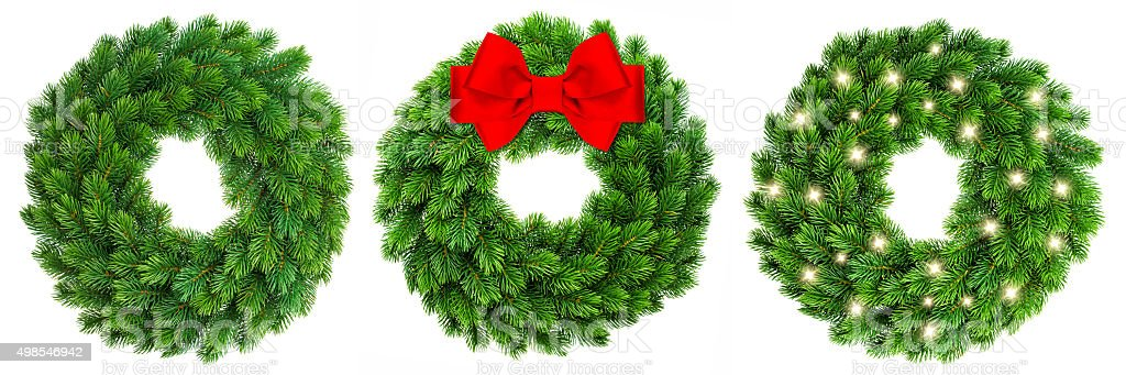 Christmas decoration evergreen wreath wit red ribbon bow lights stock photo