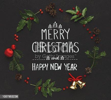 istock Christmas decoration frame on black background 1057953238