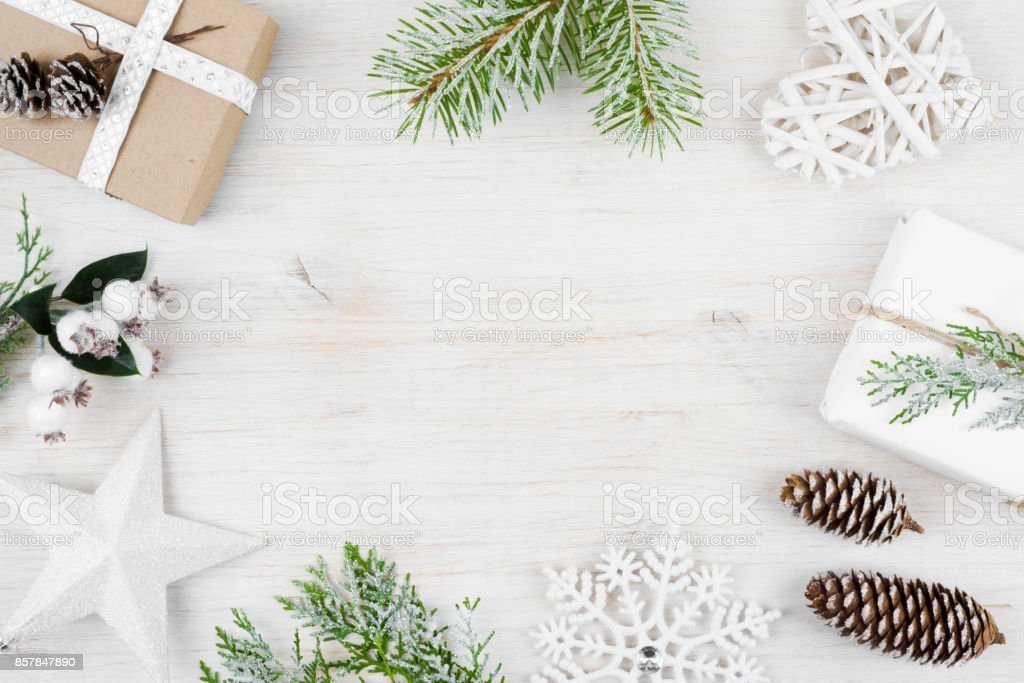 Christmas decoration, gift, frosted cypress branches, pine cones. Wooden background stock photo