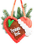 istock Christmas decoration gingerbread cookie heart with German words frohes fest 183364791