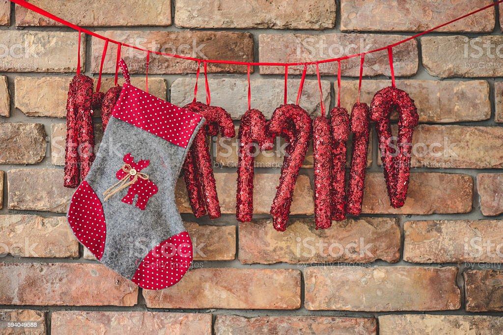 Diy Christmas Decoration Hanging Against Brick Wall Stock