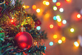 istock Christmas decoration. Hanging red balls on pine branches christmas tree garland and ornaments over abstract bokeh background with copy space 1072608926