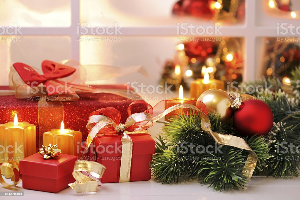 Christmas decoration in front of a frozen window stock photo