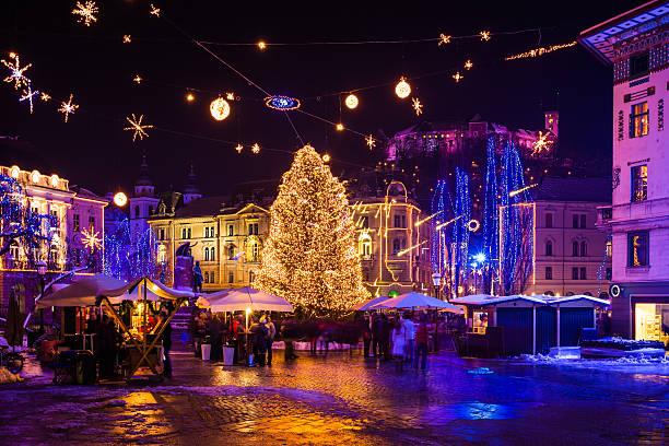 Christmas decoration lighting in Ljubljana Christmas decoration lighting of Three bridges over Ljubljanica River and Christmas tree in Ljubljana, Slovenia. 2012. ljubljanica river stock pictures, royalty-free photos & images