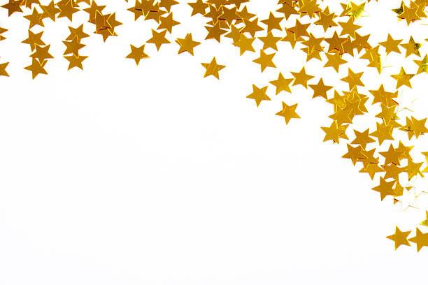Christmas decoration of golden confetti stars stock photo