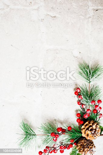 Christmas decoration of mistletoe, holly with berries,ivy and pine cones