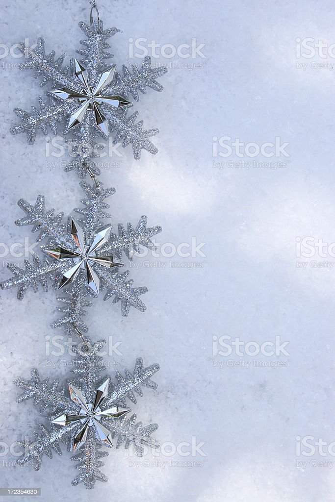 Christmas decoration of snowflakes in the snow royalty-free stock photo