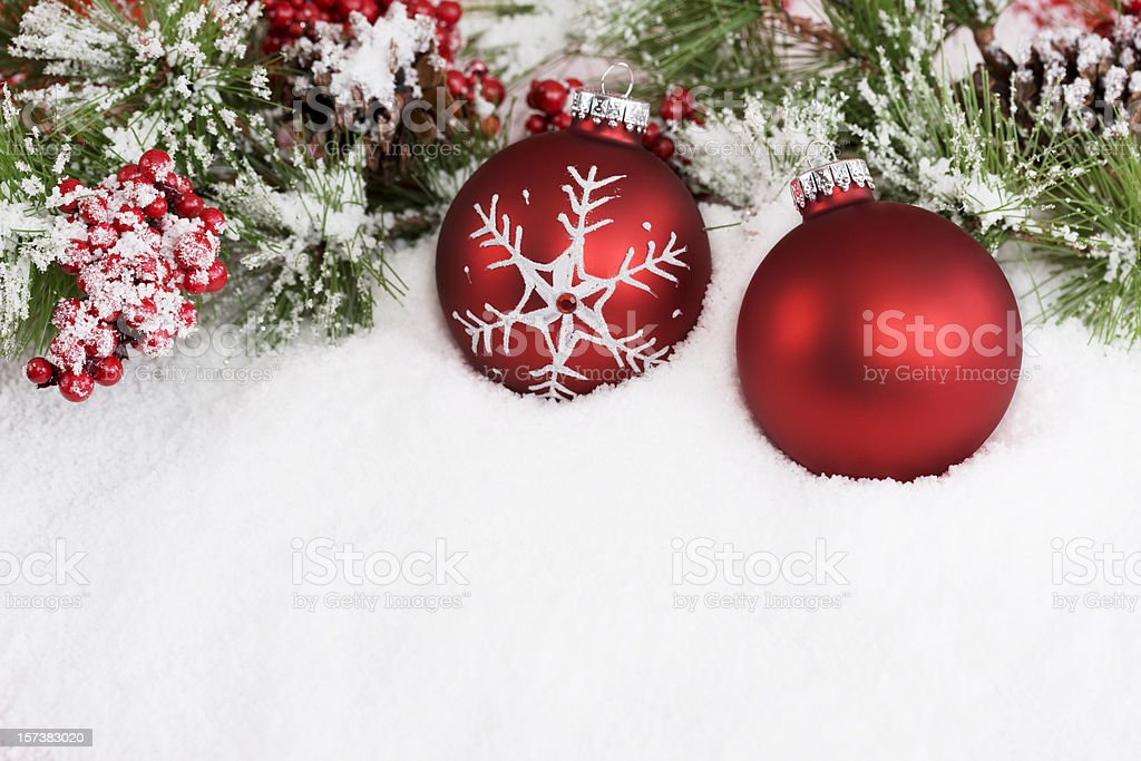 Christmas Decoration of Two Red Ornaments in Snow, Copy Space stock photo