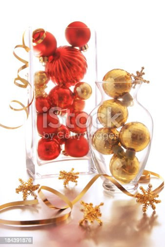 Christmas ornaments on glass vases.