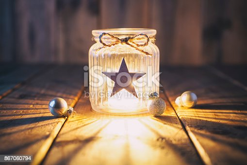 istock Christmas decoration on old wood - Candle Jar Card 867060794
