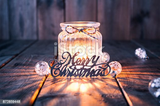 istock Christmas decoration on old wood - Candle Jar Card 872859448