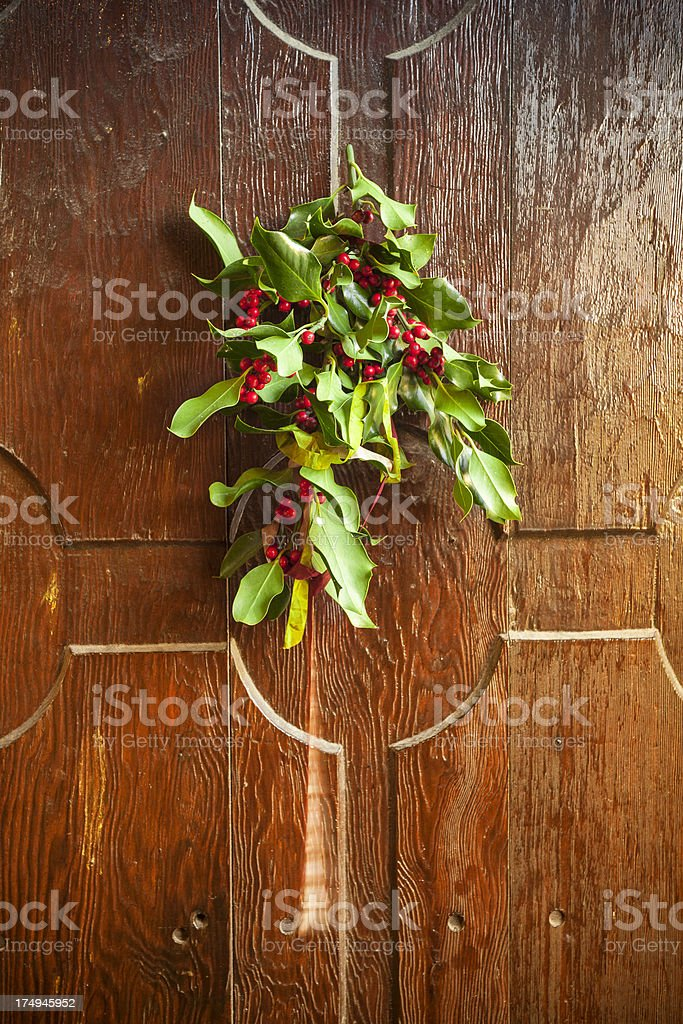 Christmas decoration on the front door stock photo