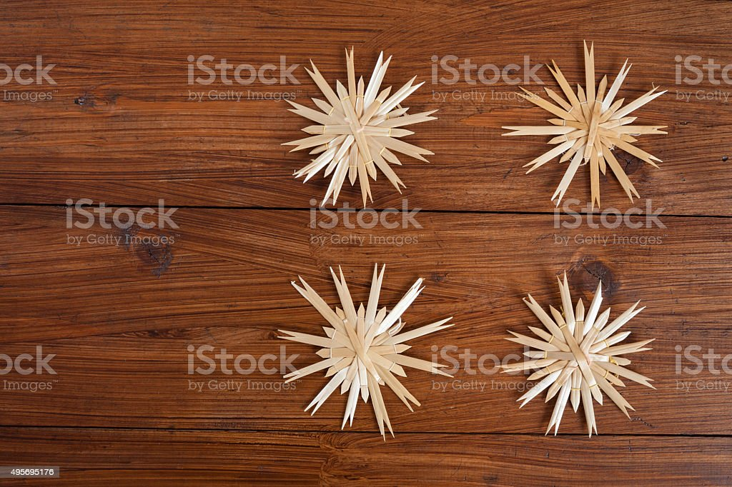 Christmas decoration on wood, straw stars, copy space stock photo