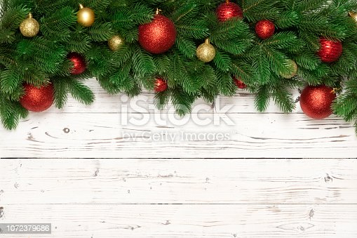 istock Christmas decoration on wooden background.  Flat lay. 1072379686