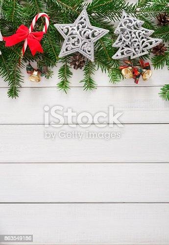 istock Christmas decoration, ornaments and garland frame background 863549186