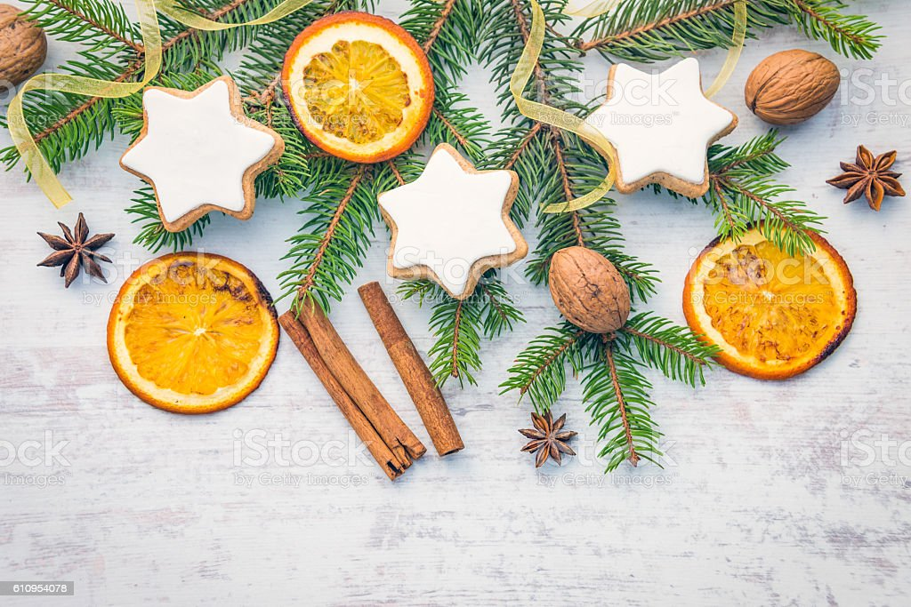 Christmas decoration over white wood background. Homemade star shaped cookies stock photo