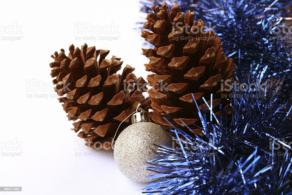 Christmas decoration - pinecones and silver ball in blue tinsel royalty-free stock photo