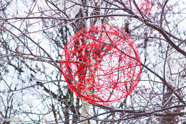 Christmas decoration red ball of yarn hanging on tree in winter park picture id673647502?b=1&k=6&m=673647502&s=612x612&h=oifolkgnakchgmtkvghylcfgcjbqyuqqbfyxr7fz1nk=