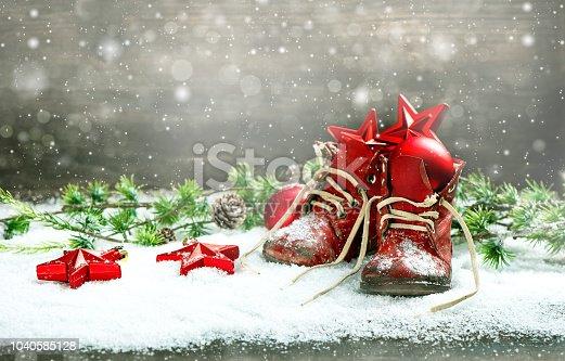 858960516 istock photo Christmas decoration red balls stars bokeh snowflakes 1040585128