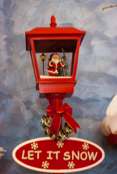 Christmas decoration, red lamp with Santa's puppet inside - foto stock