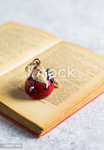 1057183432 istock photo Christmas decoration, 'Santa Claus' on a open book 1068851936