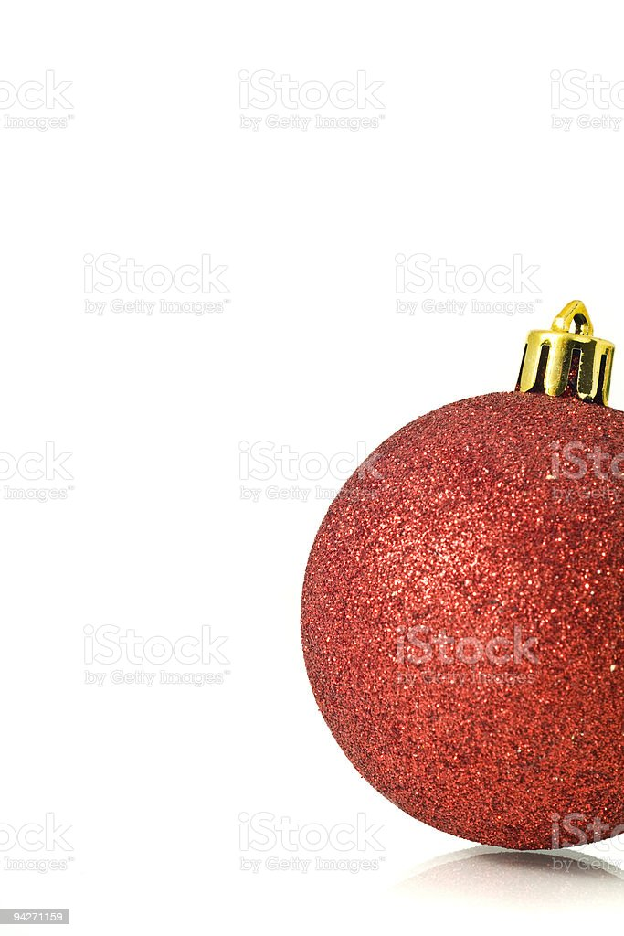 Christmas Decoration - single red ball over white royalty-free stock photo