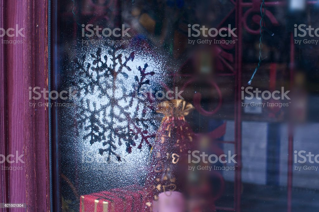 Christmas decoration snowflakes sputtering on glass stock photo