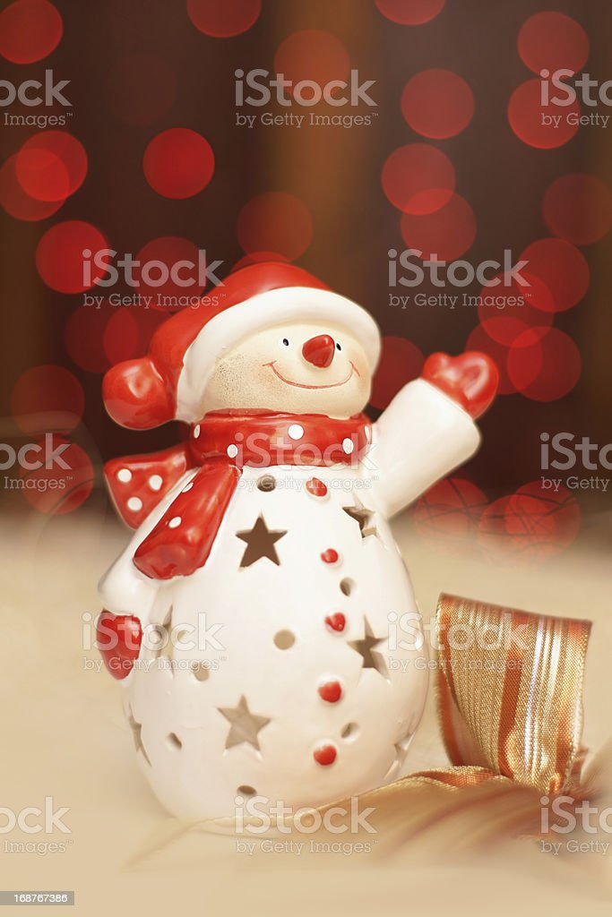 Christmas decoration, snowmen dressed as Santa Claus and red light royalty-free stock photo